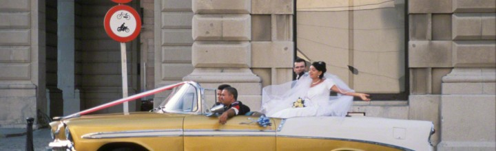 Bride and Groom in Vintage 1950s Getaway Car
