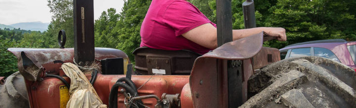 Donna Sprague driving her tractor