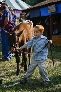 Boy Leading Heifer